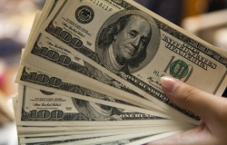 Dólar encosta em R$ 5,45 após resultados da economia americana