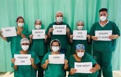 Profissionais de saúde em MT fazem campanha para incentivar população a ficar em casa: 'Fique em casa por nós'